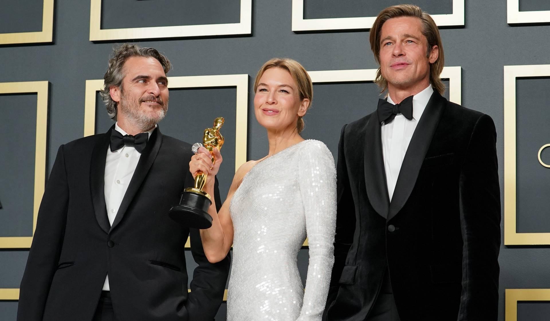 Los ganadores del premio Oscar, Joaquin Phoenix, Renée Zellweger y Brad Pitt